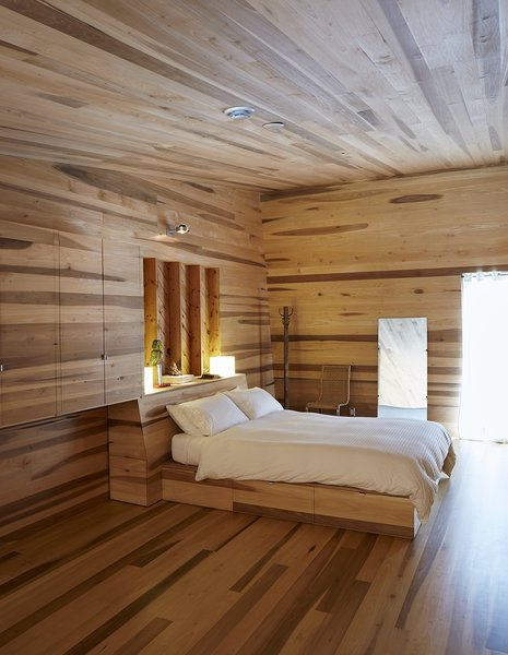 The custom bed features under-mattress drawers. Photo 9 of Sliding House modern home