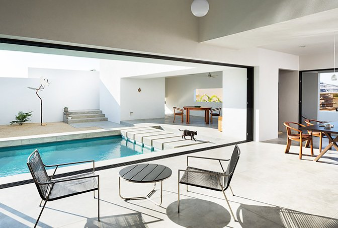 Comprised of stark whitewashed angles and box forms, the interconnecting interior is focused around the pool and open walls that allow for seamless indoor/outdoor living.  Photo 10 of 11 in 10 Modern Vacation Homes in Mexico That Guarantee an Epic Escape