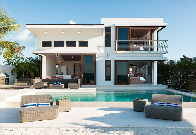 Guests can dine poolside overlooking the ocean.  Photo 8 of 10 in Find Yourself in Paradise at These 10 Modern Rentals in the Caribbean
