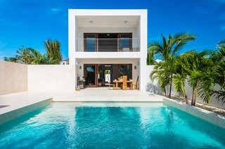 Find Yourself in Paradise at These 10 Modern Rentals in the Caribbean - Photo 9 of 10 - The open-plan living area looks out to an intimate courtyard with an infinity pool.