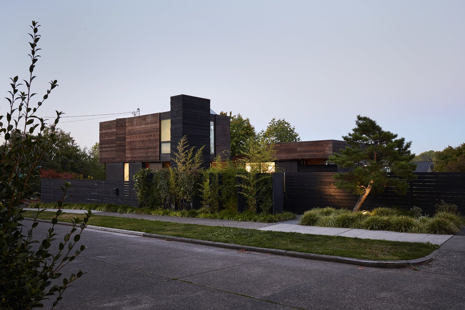 Tagged: Outdoor, Front Yard, Trees, Grass, Hardscapes, and Walkways.  Mid Century Homes by Farhan Hasan from Greener Grass