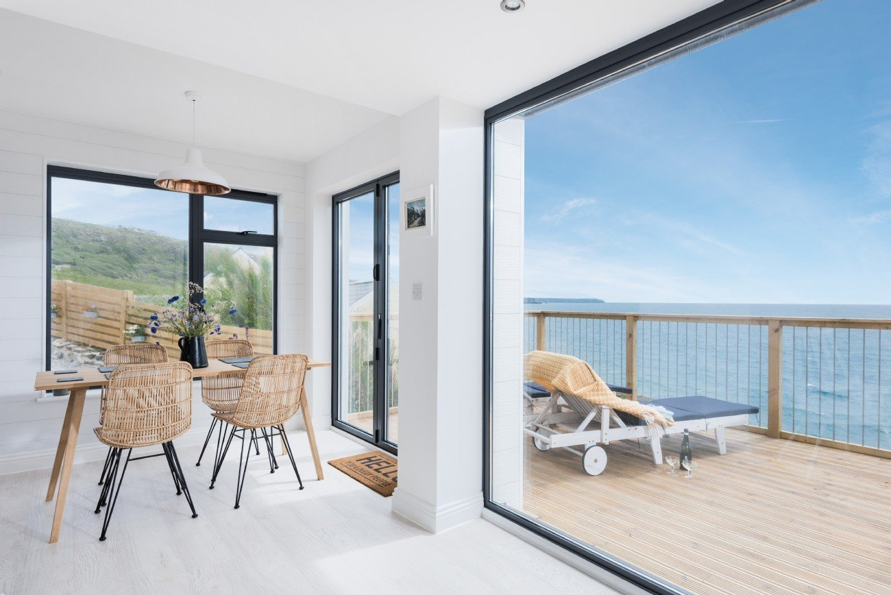 Sitting on Delphin's outdoor deck, you might be able to spot seals or dolphins.  Photo 2 of 15 in Escape For a Weekend Away at One of These Cornish Retreats That Fuse Old and New