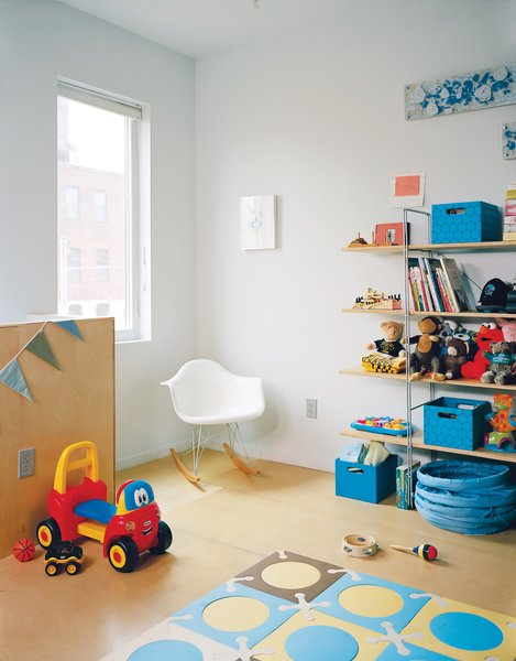 Philadelphia's Postgreen Homes filled Chad and Courtney's son's room with an Eames rocker and a Hiya crib from Spot on Square.