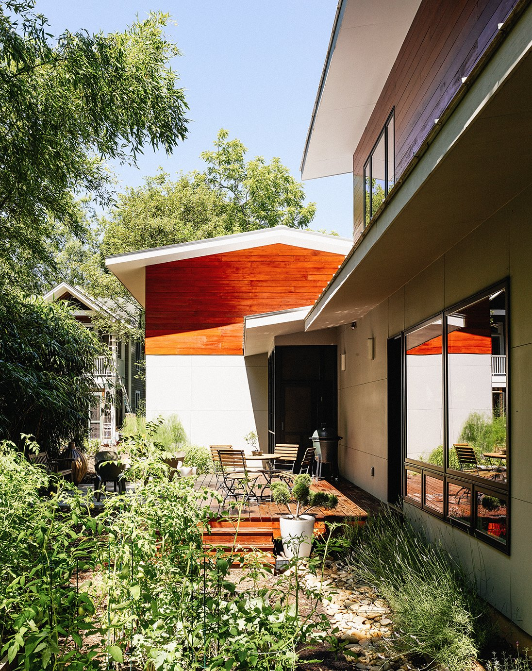 In a historic section of Raleigh, North Carolina, a modern home designed by Louis Cherry became the subject of a lengthy court battle. The house is clad in local cypress and HardiePanel siding in Stormy Monday by Benjamin Moore. Tagged: Outdoor, Vegetables, and Gardens.  Photo 2 of 10 in Shelter From the Storm