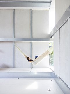 Across the Ocean - Photo 1 of 10 - Resident Débora Mesa Molina, an architect and research scientist, lounges in a hammock in the living area of the steel-and-foam prefab addition she and her husband, Anton Garcia-Abril, designed in Madrid, Spain, and assembled in nine days in Brookline, Massachusetts.