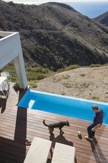 Facing the Elements - Photo 4 of 5 - Cantilevered over the hillside is a stainless steel pool by Bradford Products.