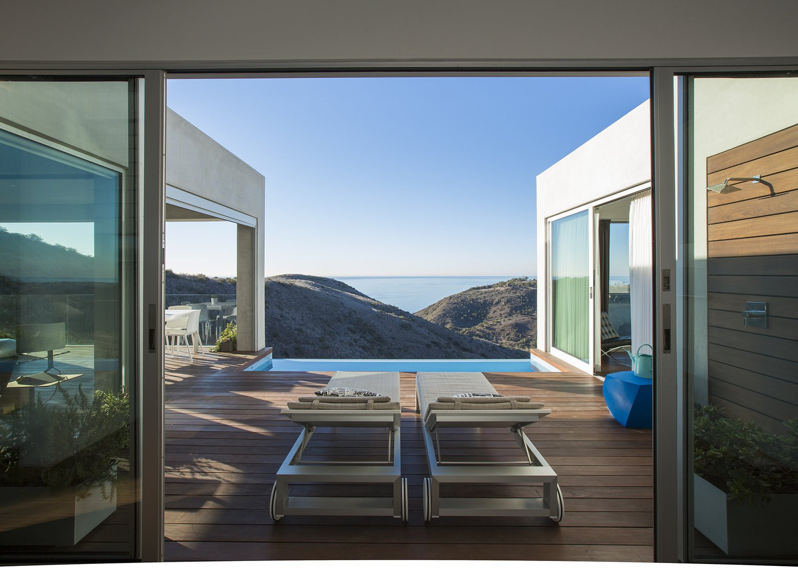 "Lounge chairs by B&B Italia on the lower-level terrace offer a spot from which to take in the ocean views. Of the outdoor shower, Dell'Acqua says, ""It's the most used thing in the house—even in the middle of winter.""  Photo 5 of 5 in Facing the Elements"