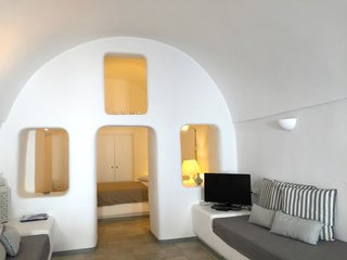 Ever Wanted to Stay in a Cave That's Actually Pretty Modern Inside? - Photo 1 of 10 - Located in the small village of Katerados, Il Melograno is a spacious two-bedroom yposkafo—a traditional Santorini-style cave house—with white-washed walls and a private sunlit courtyard.