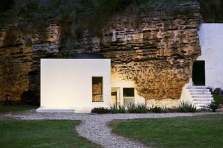 Ever Wanted to Stay in a Cave That's Actually Pretty Modern Inside? - Photo 2 of 10 - Designed by Spanish architectural practice UMM Estudio, House Villarrubia sits on the foothills of Sierra Morena in a sloping calcarenite terrain. The only cave house in Cordoba, its interiors comprise of clean, quiet volumes, glass apertures, and handcrafted wooden furniture.  It's available for rent through Airbnb.