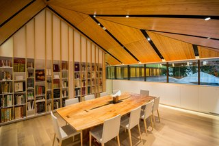 Take a Tour of Kengo Kuma's Expansion of the Portland Japanese Garden - Photo 3 of 8 - The collection of Japanese garden and cultural books is housed in the Vollum library. A custom-made George Nakashima table sits in the foreground.