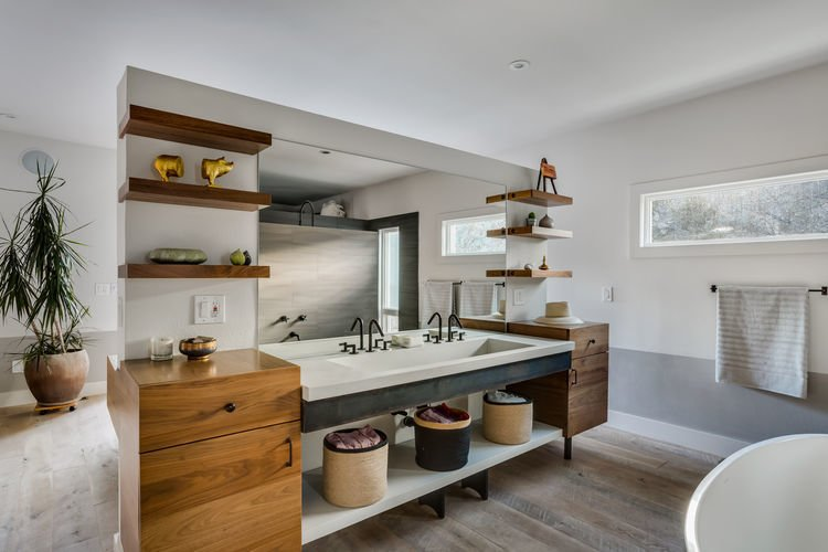Even before Juilland started on the project, the homeowners tapped Ben Dagitz of DagitzFurniture to make a few items for the home. This included the Tagged: Bath Room, Medium Hardwood Floor, Undermount Sink, and Freestanding Tub.  Frischkorn Ranch by Dwell from This Boulder Home's Unique Bedroom-Bathroom Puts a New Twist on the Open Plan