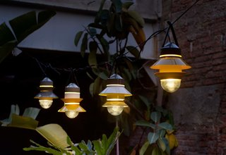 Marset's Santorini lights were designed by Sputnik Estudio. Available in white, gray, or mustard, the outdoor lamps are inspired by fishing boat lanterns and can be customized for your space—including how many shades to place on the diffuser, the order, position, and direction.