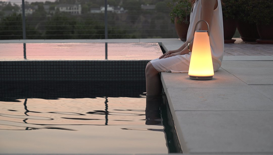 Designed for both indoors and outdoors, the portable lamp works as both a speaker and a light with bluetooth connectivity, full-range dimming control, and touch-sensitive volume control.