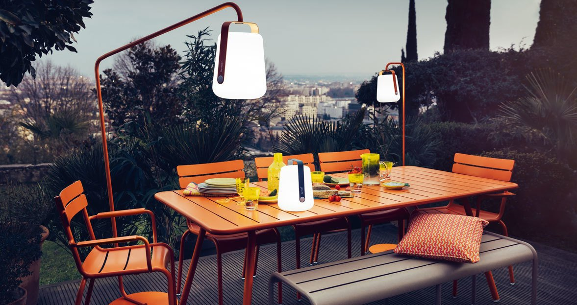 Designed by Tristan Lohner, you can choose from 7 bold colors and it can be mounted on a stand to become an outdoor floor lamp.  Photo 2 of 6 in Extend Your Time Outside With These 6 Innovative Lighting Designs For Your Outdoor Space