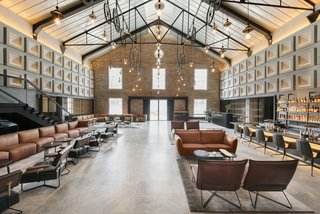 Experience a Modern, Eclectic Side of Singapore at One of These 10 City Stays - Photo 6 of 13 - Designed by Asylum and Zarch Collaborative, the converted warehouse boasts a lobby with vaulted ceilings that puts a spotlight on the original pulley systems that were commonly found in godowns.