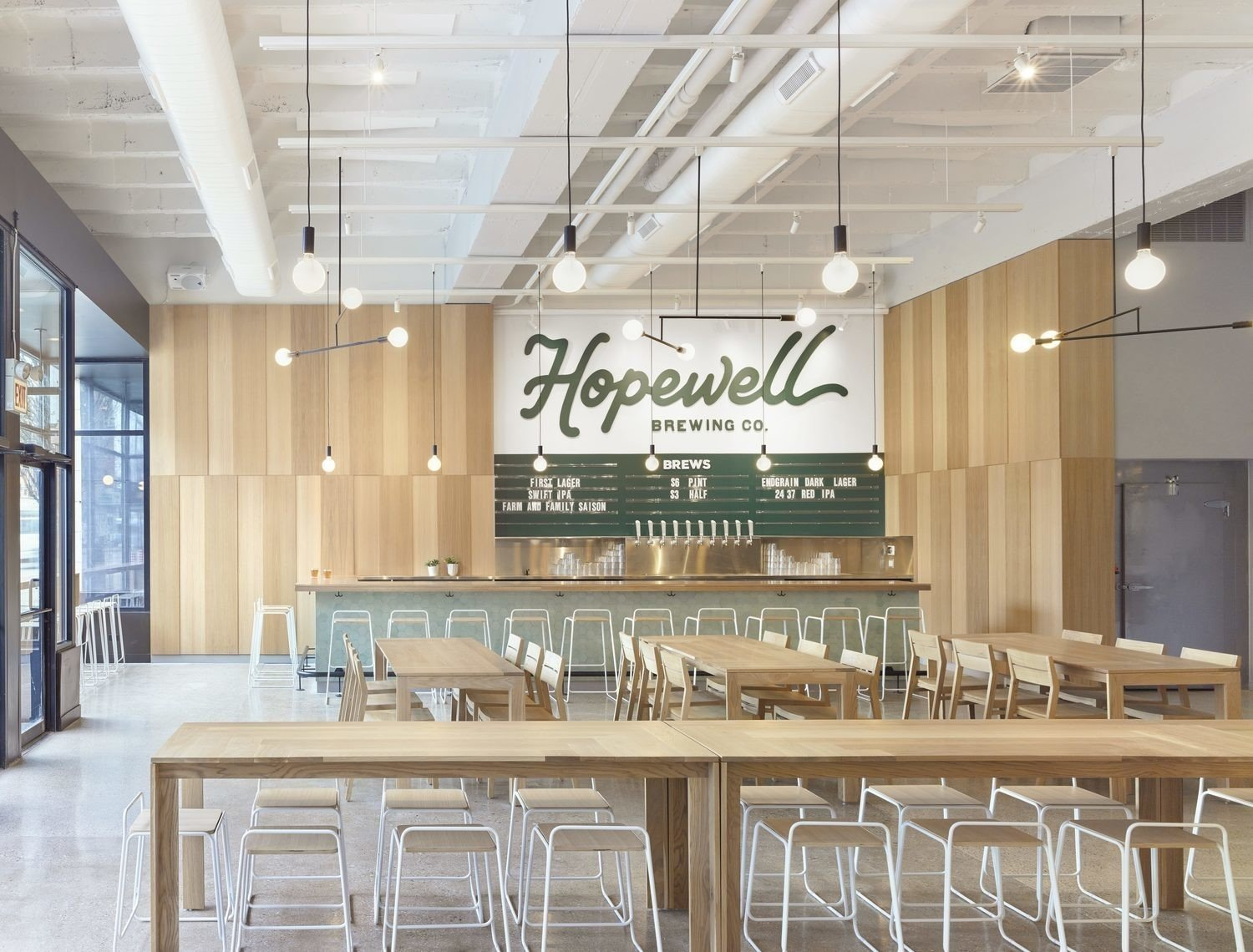 In the American midwest, Hopewell Brewing Co. manages to channel multiple styles at once. The signage has an almost 1950s nostalgia about it, while the light fixtures are utterly modern and minimalistic.  Photo 4 of 12 in 10 Brewpubs That Have Tapped the Art of Modern Design