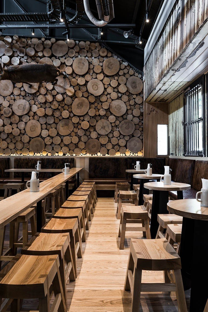 A rustic setting indeed. Between the tree trunk cross sections and mixed wood tones throughout the space, this beer house makes you feel like you are gathering in a Bavarian forest. 10 Cozy Spaces and 15 Products to Help You Get Ready For Fall - Photo 10 of 10