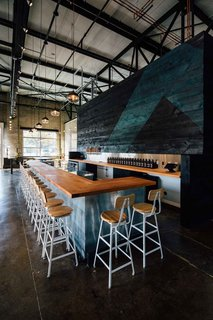 10 Brewpubs That Have Tapped the Art of Modern Design - Photo 8 of 12 - To outfit the 10,000-square-foot factory space, Hank Butitta  worked with local materials and manufacturers. He framed original elements of the building with simple forms while focusing on the power of its negative spaces.
