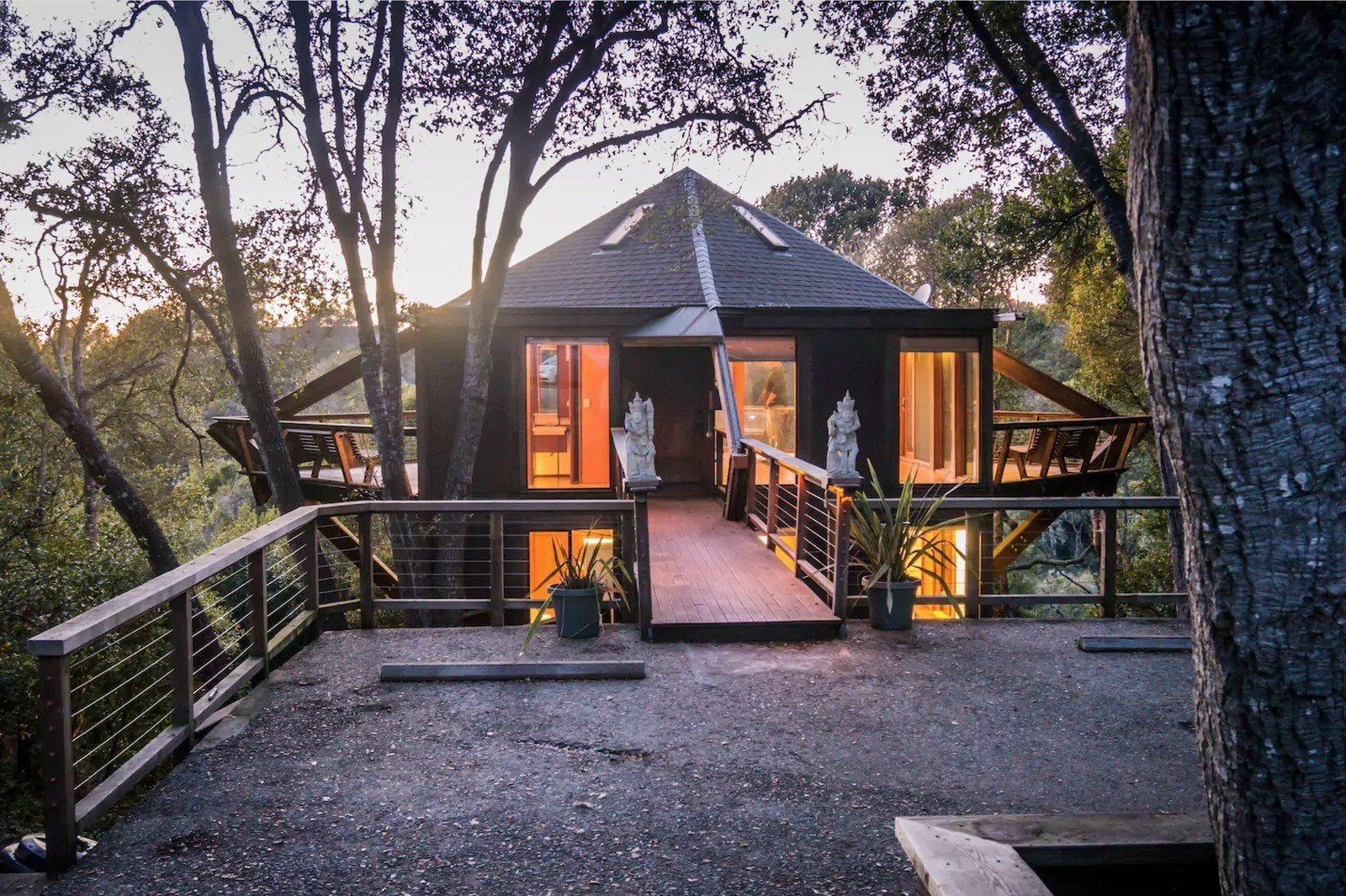 This tree house that's available to rent through Airbnb in Aptos, California, sits next to a Redwood State Forest and was built seamlessly into the local trees.  Photo 15 of 16 in 15 Brilliant Designs That Work Around Nature