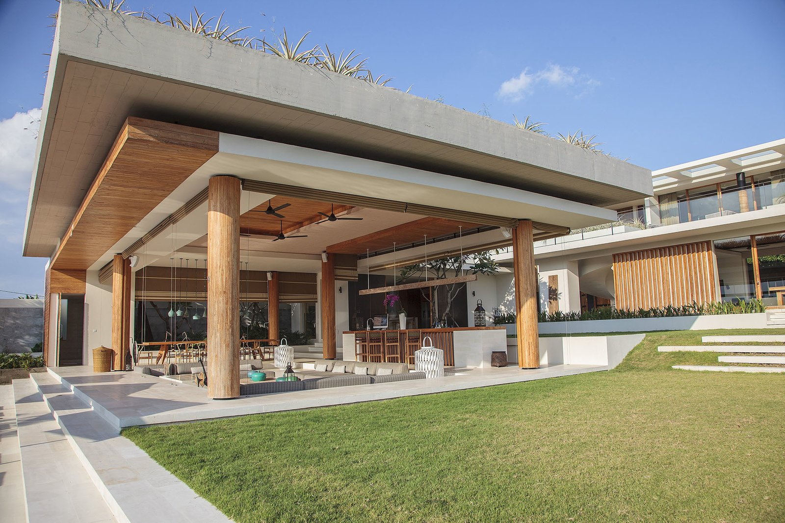 With its cutting-edge design, clean lines, local stone and honey-hued wood interiors, The Iman Villa is sophisticated choice for large groups of families. The villas has a lovely rooftop terrace that overlooks rice paddies, a swimming pool and children's wading pool and a luxurious sunken Jacuzzi.