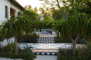 10 Modern Gardens That Freshen Up Traditional Homes - Photo 2 of 10 - In this garden by Mark Tessier, tiled stairs with a modern pattern bring a geometric and playful touch to this traditional home.