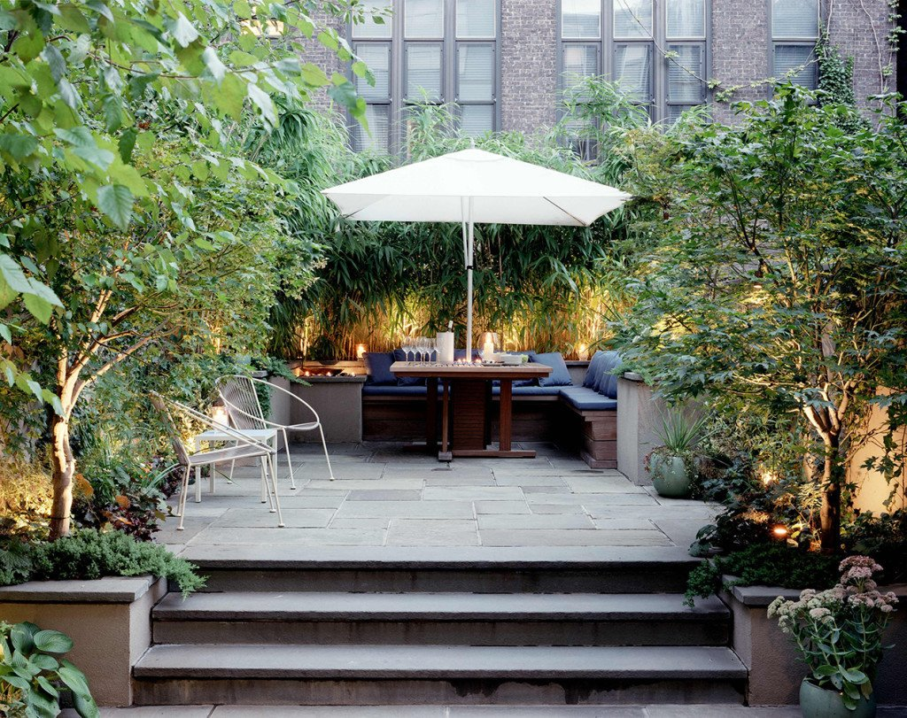 Elysian Landscapes modernized a classic brownstone by creating a private bi-level patio with clean, built-in seating for outdoor dining. 10 Modern Gardens That Freshen Up Traditional Homes - Photo 4 of 11
