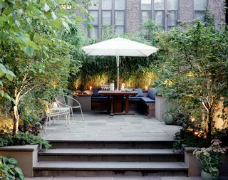 10 Modern Gardens That Freshen Up Traditional Homes - Photo 3 of 10 - Elysian Landscapes modernized a classic brownstone by creating a private bi-level patio with clean, built-in seating for outdoor dining.
