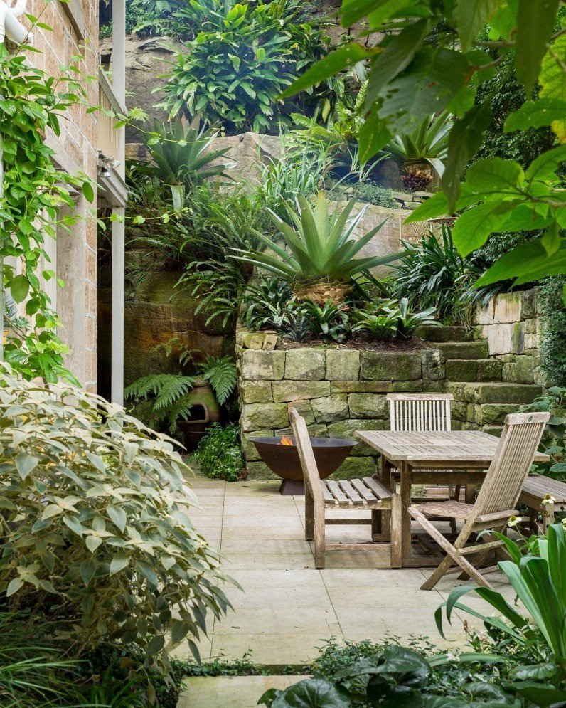 As the founder of one of Sydney's leading landscape companies, Michael Bates updated the garden of his 100-year-old sandstone home in North Sydney. He augmented the existing plantings and made the spaces more functional and ready for entertaining. He chose a focused selection of plants with broad leaves.