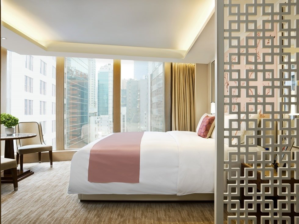 Located in the heart of Hong Kong's downtown core, The Pottinger's 68 luxury rooms and suites celebrate Hong Kong's rich cultural heritage with chinoiserie details and striking photographs from famous Hong Kong photographer and filmmaker Fan Ho.
