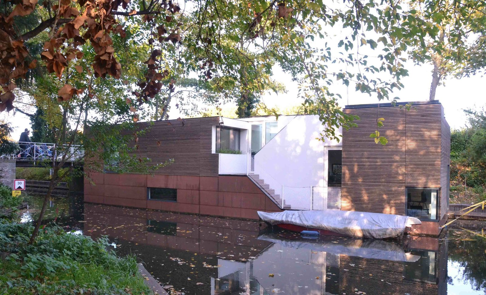 Anchored beside a wooded parkland, this houseboat in the Netherlands was designed by BYTR Architects.  Photo 4 of 11 in 10 Modern Floating Homes That Offer an Aquatic Lifestyle