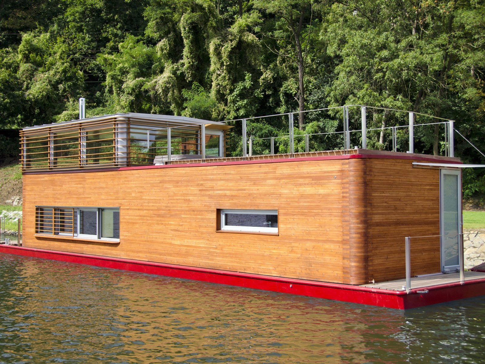 This full-fledged floating house was designed with features that are meant to live comfortably year-round. Tagged: Exterior, Wood Siding Material, and Boathouse Building Type.  Photo 9 of 11 in 10 Modern Floating Homes That Offer an Aquatic Lifestyle