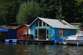10 Modern Floating Homes That Offer an Aquatic Lifestyle - Photo 10 of 10 - This project was reconstructed from an old houseboat that was anchored in the sailing club in Smichov.