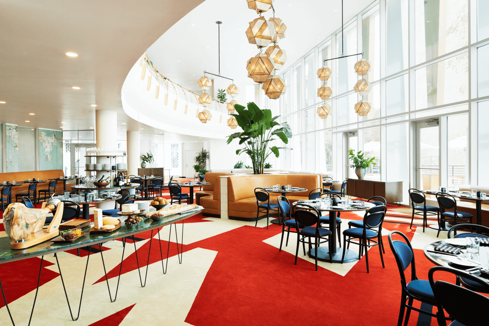 The 53 rooms of The Durham Hotel – a mid-century modern boutique, hotel in the heart of downtown Durham are decked out in the bold Bauhaus colors of yellow, red and blue.  Photo 8 of 12 in Follow Us to 10 Midcentury Modern-Inspired Hotels Around the Globe