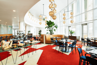 Follow Us to 10 Midcentury Modern-Inspired Hotels Around the Globe - Photo 7 of 11 - The 53 rooms of The Durham Hotel—a midcentury-modern boutique hotel in the heart of downtown Durham—are decked out in the bold Bauhaus colors of yellow, red, and blue.