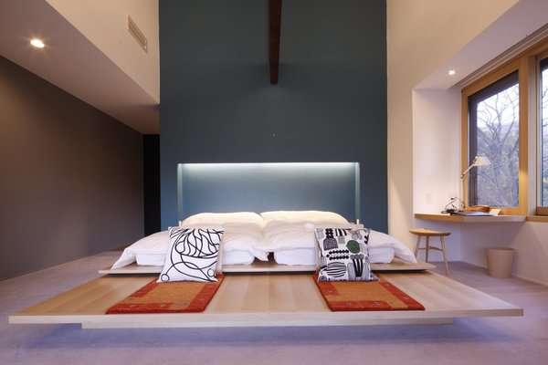Hide Out in One of These Asian Retreats That Are Immersed in Nature - Photo 2 of 12 - Satoyama Jujo is a countryside hotel that features cypress-and-cedar wood floors, spectacular mountain views, and furniture by Arne Jacobsen, Hans Wegner, and Isamu Noguchi.