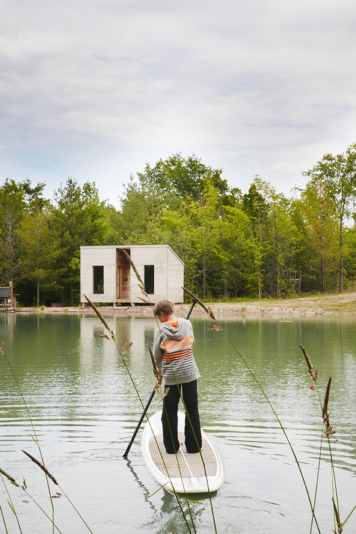 Cooper, 11,  paddleboards toward an outbuilding that contains a sauna.  Photo 5 of 11 in Hot to Trot