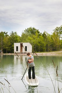 Hot to Trot - Photo 5 of 11 - Cooper, 11, <br>paddleboards toward an outbuilding that contains a sauna.