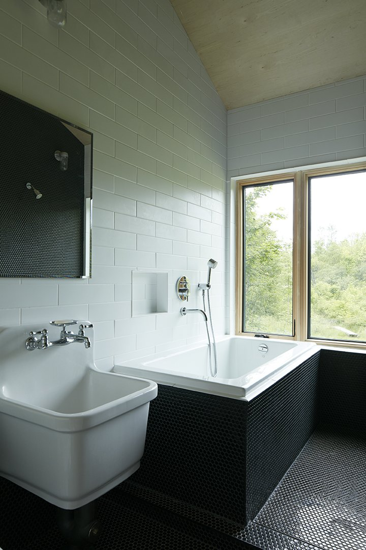 In the bathroom, the sink is by Kohler and the tub is by Maax.  The Land House by Dwell from Hot to Trot
