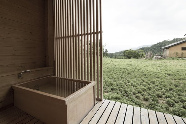 Hide Out in One of These Asian Retreats That Are Immersed in Nature - Photo 1 of 12 - A two-hour ride on a high-speed train from Tokyo will take you to Satoyama Jujo in Minami-Uonuma. An open-air bathtub allows you to literally immerse yourself in nature.