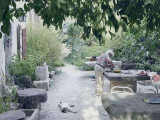 Mine Dining - Photo 6 of 18 - He is fond of telling the story of a large stone table he bought from an antique dealer. When the deliveryman arrived, his truck couldn't fit through the gate, so Lolo hauled the table into the courtyard himself, inching it into place over several days.