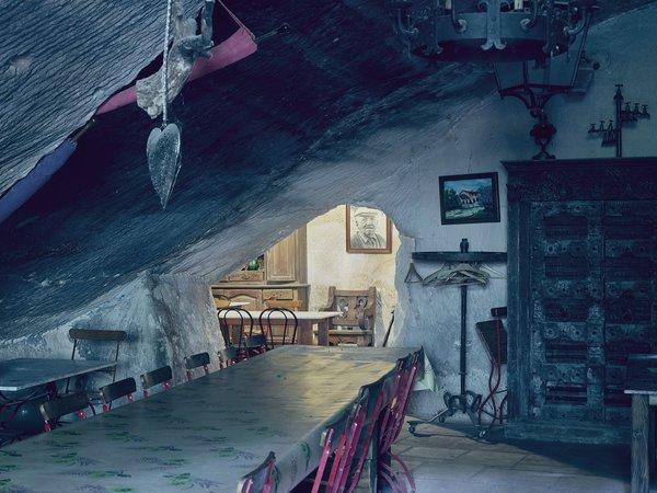In winter, guests dine indoors. Photo 10 of Mas de la Pyramide modern home