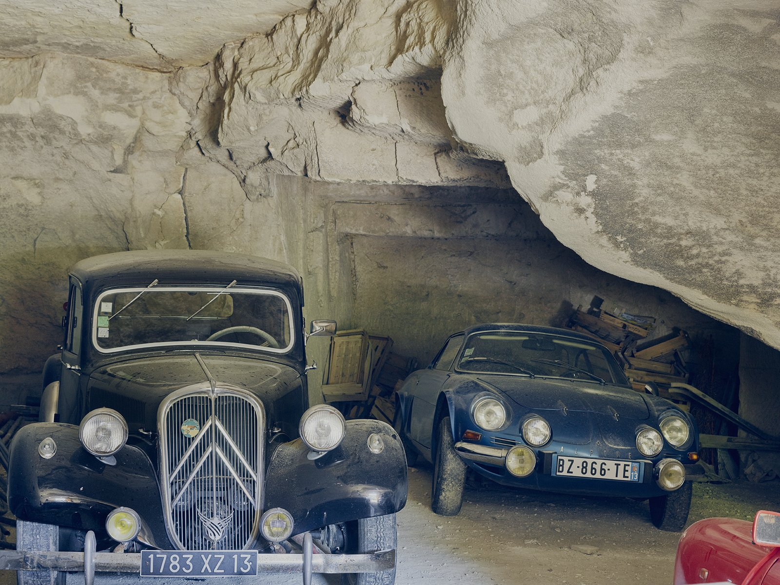 The fleet includes a ruby-red Renault Dauphine and a black Citroën Traction Avant. Tagged: Garage.  Photo 14 of 19 in Mine Dining