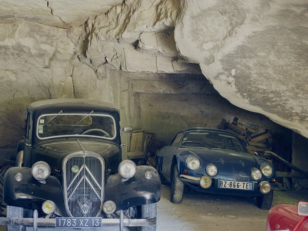 The fleet includes a ruby-red Renault Dauphine and a black Citroën Traction Avant. Photo 14 of Mas de la Pyramide modern home