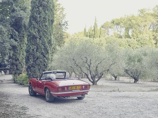 Mine Dining - Photo 15 of 18 - Lolo eases his Triumph Spitfire convertible, designed by Giovanni Michelotti, into the driveway.