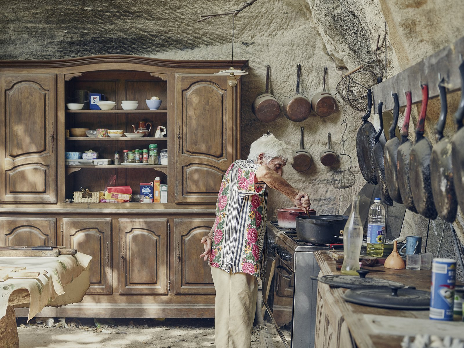 In the limestone kitchen embedded in the hillside, Lolo keeps only proven essentials—skillets that have been seasoned countless times and furniture that has been passed down for generations.