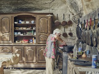 Mine Dining - Photo 2 of 18 - In the limestone kitchen embedded in the hillside, Lolo keeps only proven essentials—skillets that have been seasoned countless times and furniture that has been passed down for generations.