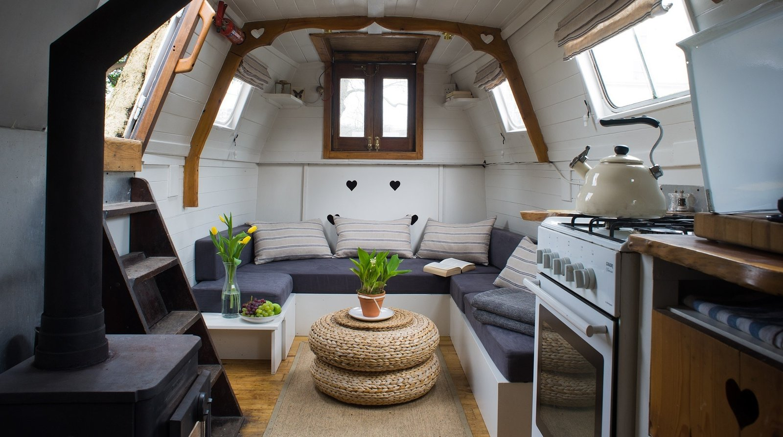 Spend the night on this gorgeous steampunk meets cozy cottage canal boat, and rise to the sounds of birdsong on London's River Thames.  Photo 10 of 11 in Make Yourself at Home in One of These Small Spaces on Boats That You Can Rent