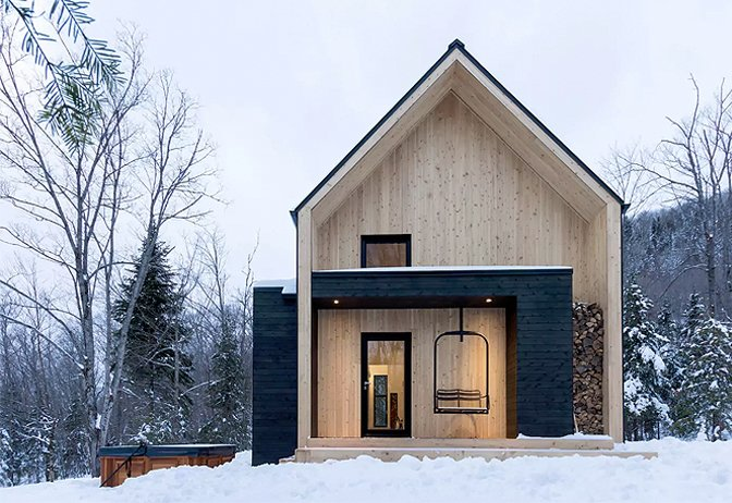 Just ten minutes away from Quebec's popular ski area – Le Massif de Charlevoix, this Scandi-inspired cabin is much larger than it looks, and can comfortable accommodate up to 14 guests.  Photo 3 of 10 in Get Back to Basics by Staying at One of These Modern Cabins