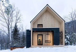 11 Alluring A-Frame Homes You Can Rent Right Now - Photo 6 of 11 - Just 10 minutes away from Quebec's popular ski area Le Massif de Charlevoix, this Scandinavian-inspired cabin is much larger than it looks, and can comfortably accommodate up to 14 guests.