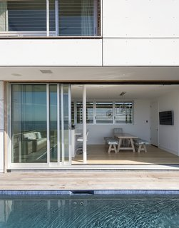 Shore Bet - Photo 8 of 13 - Having a strong outdoor element was also important. <br>A 32-foot-wide Solar Innovations sliding door connects the kitchen <br>to a deck and pool.